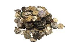 Diversos relojes de la antigüedad en blanco Fotos de archivo libres de regalías