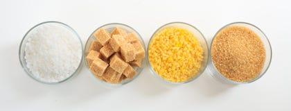 Diversos tipos de azúcar en el fondo blanco Foto de archivo libre de regalías