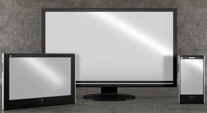 Diversos tipos de pantallas en fondo concreto Front View Fotos de archivo