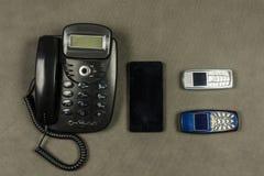 Diversos tipos de teléfonos Fotografía de archivo libre de regalías
