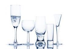 Diversos vidrios con el líquido transparente Imagen de archivo