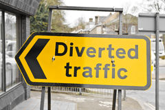 Diverted traffic. Yellow diverted traffic sign in a UK town royalty free stock photos