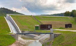 Diverted water at the dam. Flooding and heavy rain in the Czech Republic. Cloudy sky Stock Photos