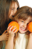Divertimento con gli aranci Immagini Stock