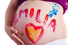 Divertimento della pittura con la gravidanza Immagini Stock Libere da Diritti