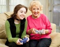Divertimento do jogo video com avó Fotografia de Stock