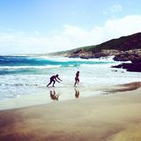 Divertimento na praia Imagens de Stock