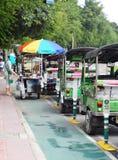 Divertimento TAILANDESE dell'aria aperta delle tre-ruote tradizionali e taxi di urbano ben noto e di BANGKOK Immagini Stock