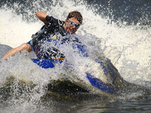 Dives Man on jet-ski. Man on Wave Runner dives in the water Royalty Free Stock Image