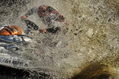 Dives Man on jet-ski. Man on Wave Runner dives in the water, competition on the river Vuoksa Petersburg, Russia Stock Photography