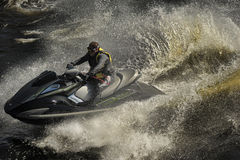 Dives Man on jet-ski. Man on Wave Runner dives in the water, competition on the river Vuoksa Petersburg, Russia Stock Photo