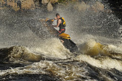 Dives Man on jet-ski. Man on Wave Runner dives in the water, competition on the river Vuoksa Petersburg, Russia Royalty Free Stock Image