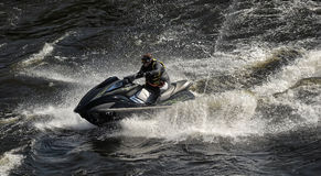 Dives Man on jet-ski. Man on Wave Runner dives in the water, competition on the river Vuoksa Petersburg, Russia Stock Image