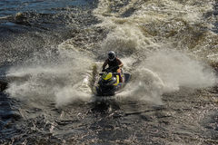 Dives Man on jet-ski. Man on Wave Runner dives in the water, competition on the river Vuoksa Petersburg, Russia Royalty Free Stock Photos