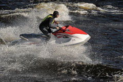 Dives Man on jet-ski. Man on Wave Runner dives in the water, competition on the river Vuoksa Petersburg, Russia Stock Photos