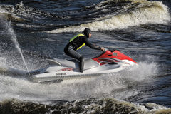 Dives Man on jet-ski. Man on Wave Runner dives in the water, competition on the river Vuoksa Petersburg, Russia Stock Images