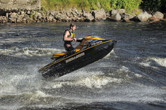 Dives Man on jet-ski. Man on Wave Runner dives in the water, competition on the river Vuoksa Petersburg, Russia Royalty Free Stock Photo