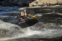 Dives Man on jet-ski. Man on Wave Runner dives in the water, competition on the river Vuoksa Petersburg, Russia Royalty Free Stock Photography