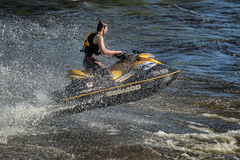 Dives Man on jet-ski. Man on Wave Runner dives in the water, competition on the river Vuoksa Petersburg, Russia Royalty Free Stock Images