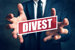 Divestment concept with businessman in suite Royalty Free Stock Photography