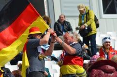 Diviértase las diversiones Team Germany con las banderas nacionales y las medallas Foto de archivo