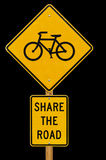 Divida la strada con il segno delle biciclette Immagine Stock