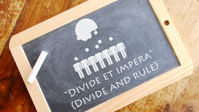 "Divide et impera. A Latin phrase that means ""Divide and rule"". Stock Photos"