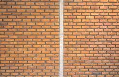 Divide half brown brick wall. Royalty Free Stock Photo