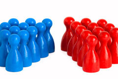 Divided. Conceptual shot showing to groups facing eachother symbolizing the concept of division, conflict, polarization (i.e. between Democrats and Republicans Royalty Free Stock Image