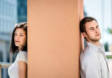 Divided - couple outdoor portrait Royalty Free Stock Photography