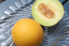 Divided Galia melon. Sweet Galia melon with seed Royalty Free Stock Photos