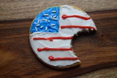 Divided Patriotic cookies. Patriotic decorated cookies divided. America divided by political turmoil. Political divisions Stock Photo