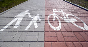 Divided sidewalk. A view of a wide concrete sidewalk with lanes designated for pedestrian and bicycle traffic Royalty Free Stock Photography