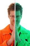 Dividen al trabajador en dos porciones Imagen de archivo