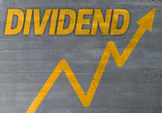 Dividend graph concept on cement texture background.  Royalty Free Stock Photo