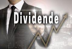 Dividende in Duits dividend wordt getoond door zakenmanconcept royalty-vrije stock afbeelding