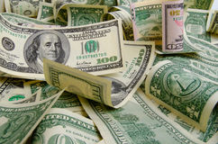 Dividends. Cash dollars lying on the plane royalty free stock photo