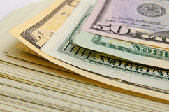 Dividends. Cash dollars lying on the plane stock photos