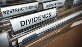 Dividends. File tab with focus on the word dividends. Conceptual image for illustration of company restructuring plan and dividend Stock Photos