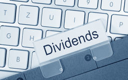 Dividends folder on computer keyboard. Dividends folder register index on computer keyboard in the office royalty free stock images