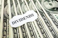 Dividends money. Dividends message on hundred dollar bills Royalty Free Stock Photo
