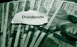 Dividends payment. Hundred dollar bills with Dividends news headline Stock Photos