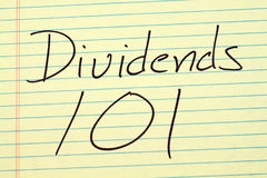 Dividends 101 On A Yellow Legal Pad. The words `Dividends 101` on a yellow legal pad stock photography