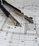 Divider on architectural plan. Divider laying on the architectural plan royalty free stock photos