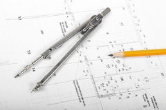 Divider and pencil on architectural blueprints Stock Images