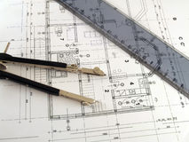 Divider and ruler on architectural plan. Dividers and ruler laying on architectural plan Stock Photography