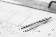 Divider on technical drawing. Vintage divider placed on a technical drawing Stock Image