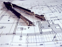Dividers on architectural paln. Dividers on the architectural project Stock Image