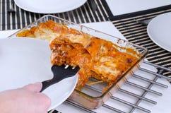 Dividing lasagna Royalty Free Stock Image
