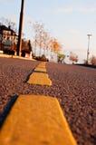 Dividing line. Yellow dividing line on asphalt road Stock Image